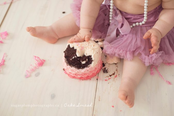 Close-up of smashed cake on set with baby touching