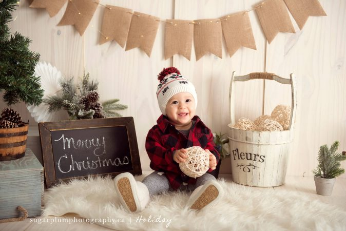 Young baby laughing for festive holiday portrait on set