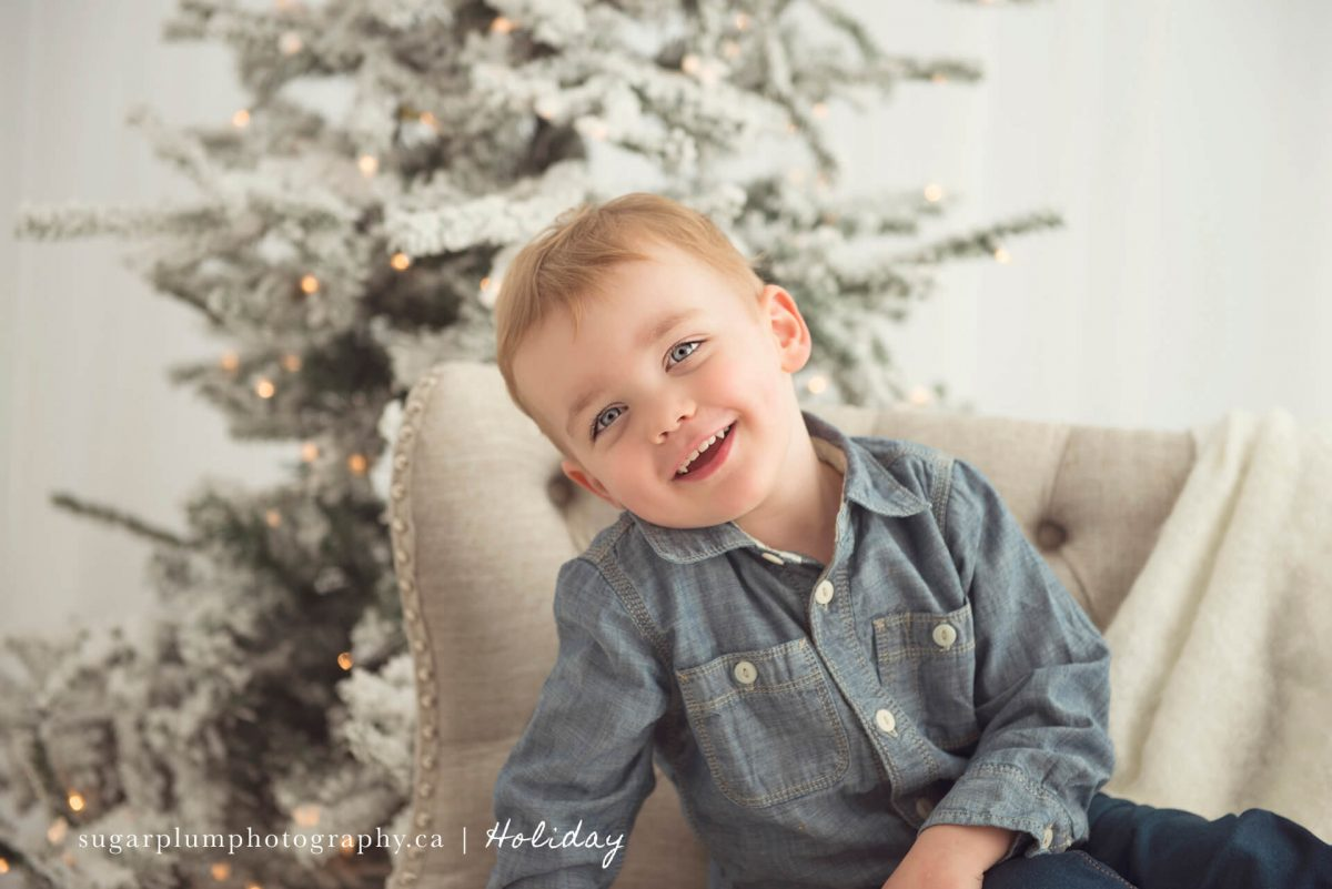 Young boy smiling for Christmas photo