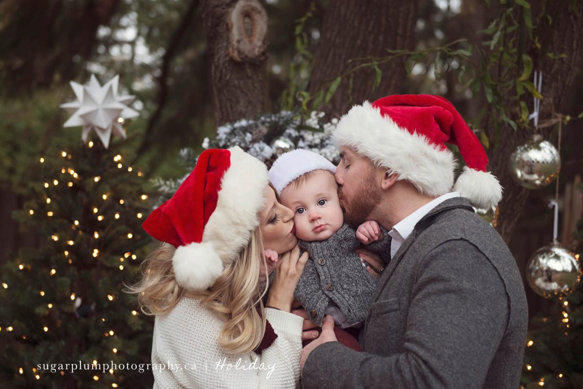 Parents kissing baby boy for holiday picture