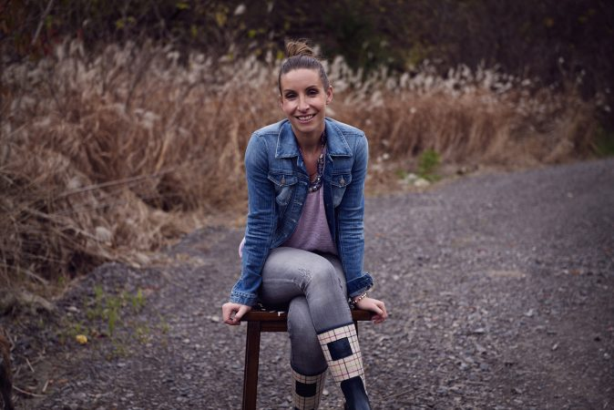 Gosia Dixon sitting on stool on trail