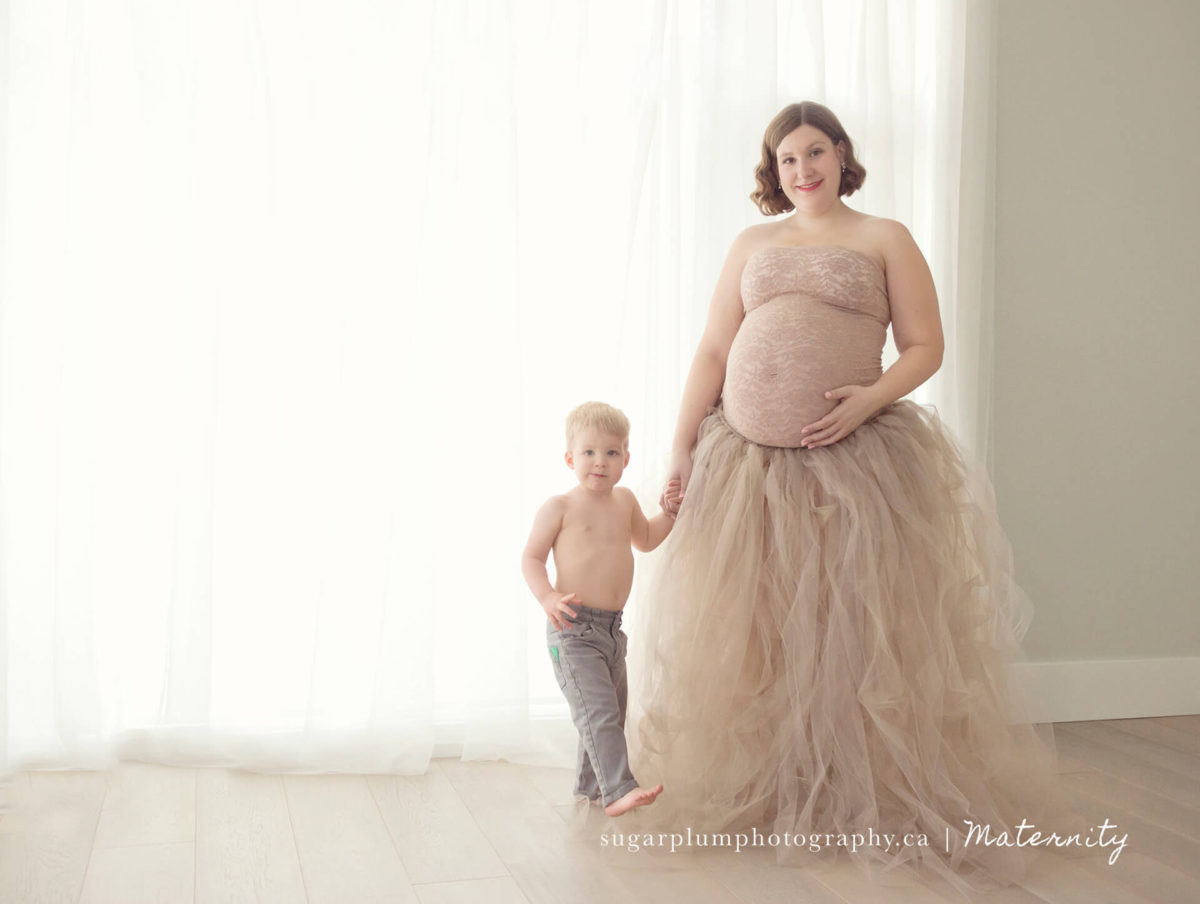 maternity in studio whimsical with son