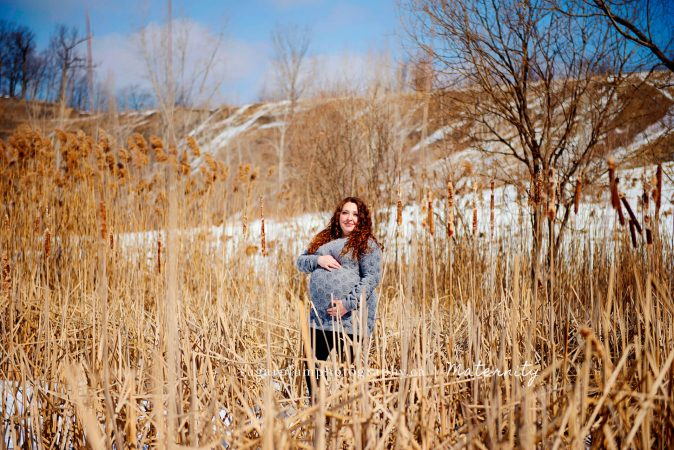 Pregnant woman in pussy willow field
