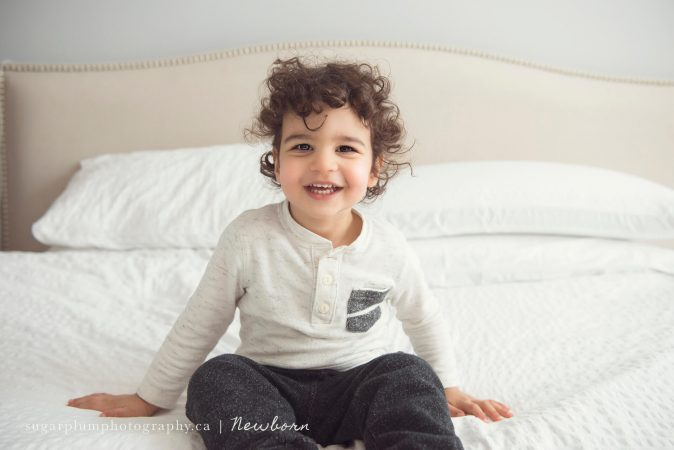 Smiling sibling in master bedroom