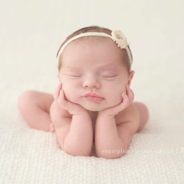 Newborn photography head in hands pose