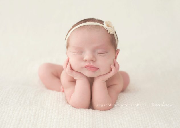 Newborn head in hands pose