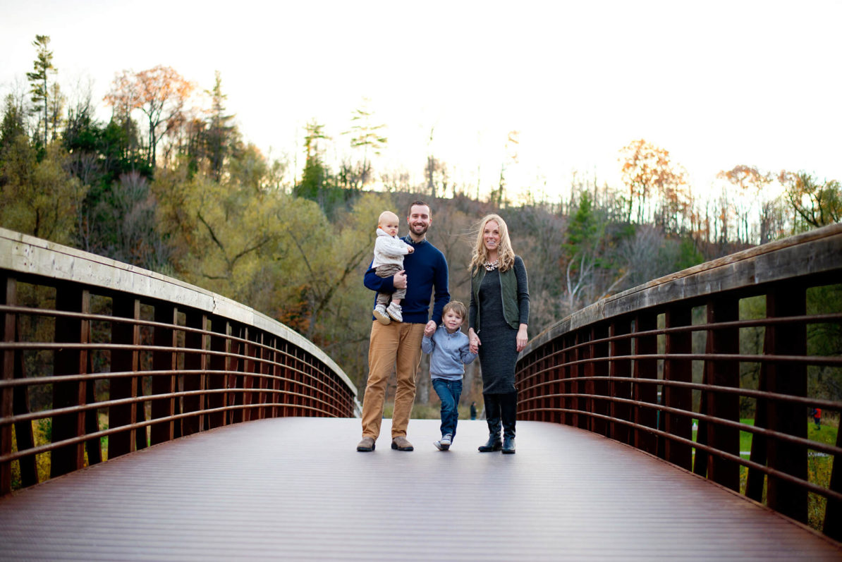 Family posing on bridge