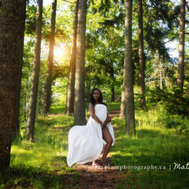 pregnant mom on wooded path