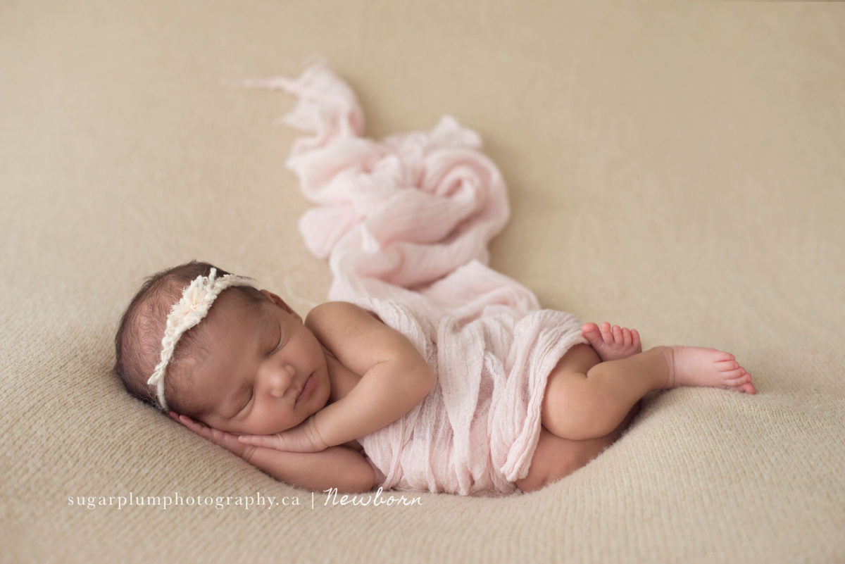 Frontal side pose on blanket baby girl