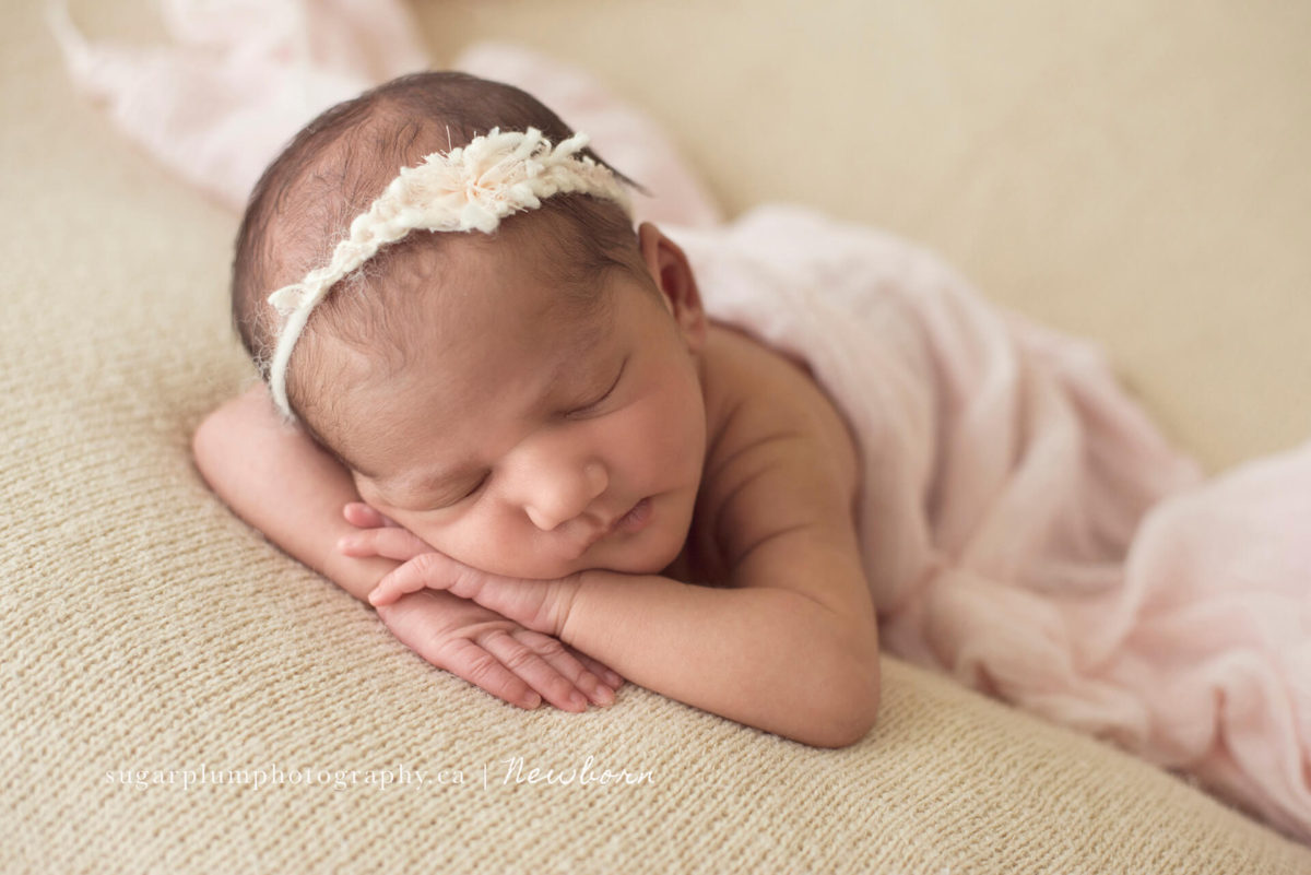 Newborn baby girl in face feature pose