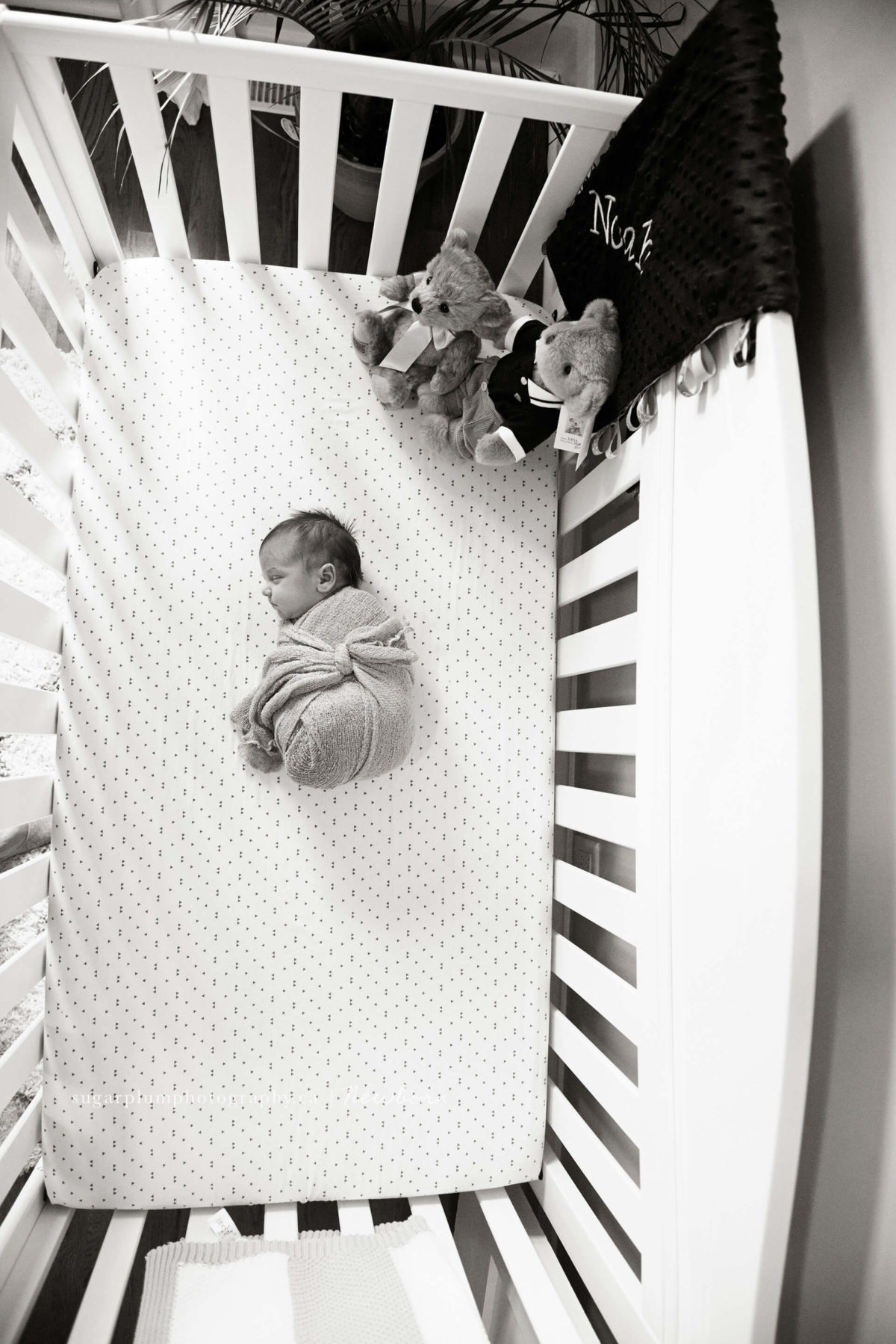 aerial view of baby sleeping in crib