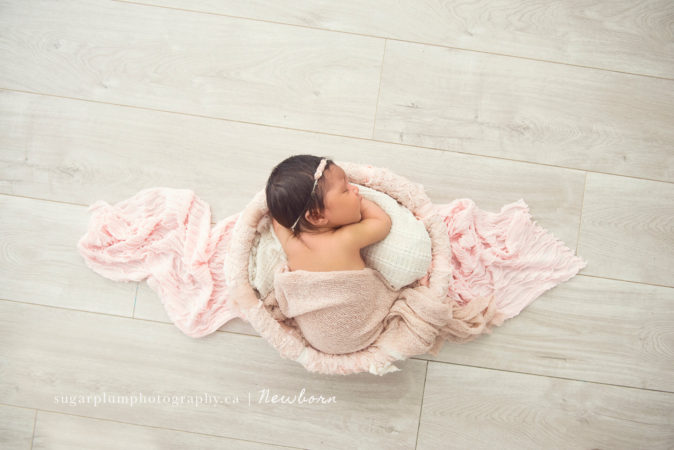 aerial view of sleeping newborn baby girl