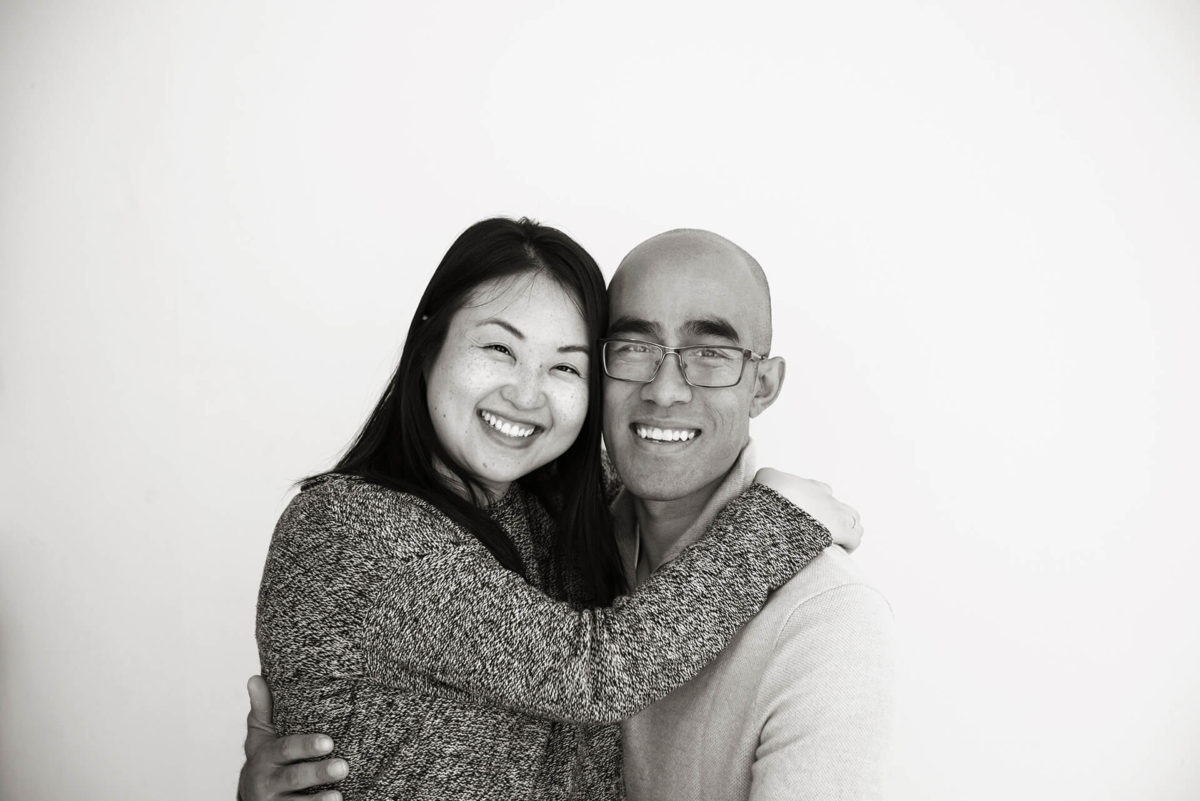 Asian couple embracing in family portrait