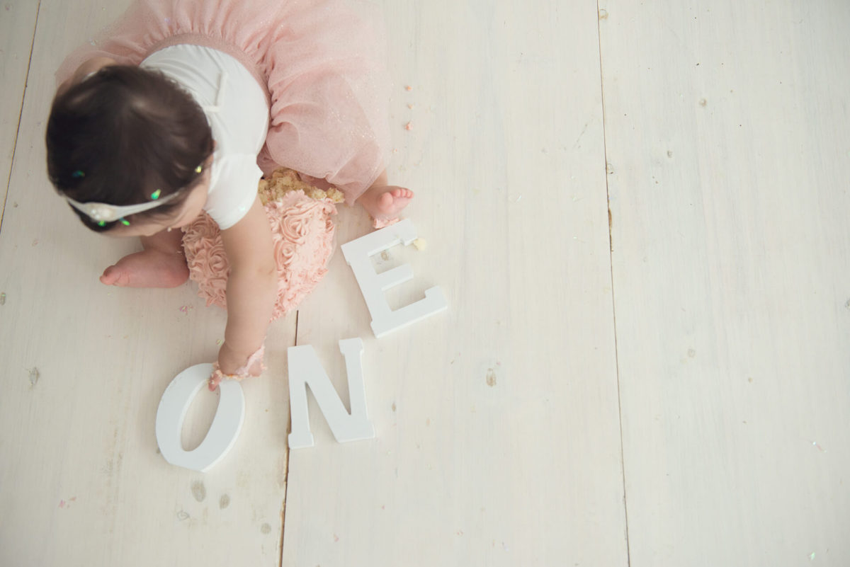 baby girl playing with wooden letters