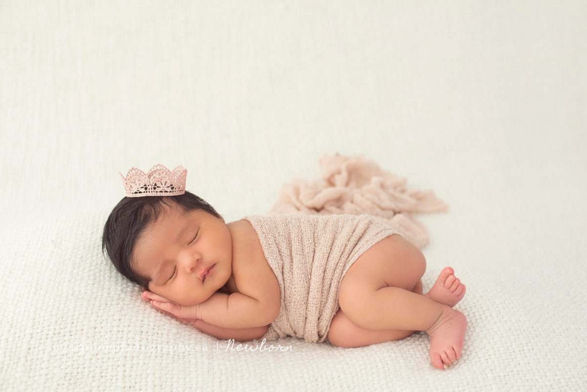 baby in Side pose on blanket