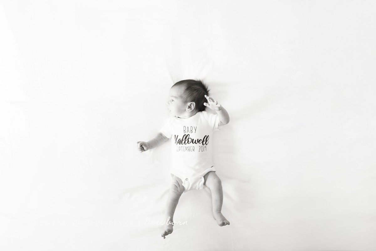 baby in tshirt announcement