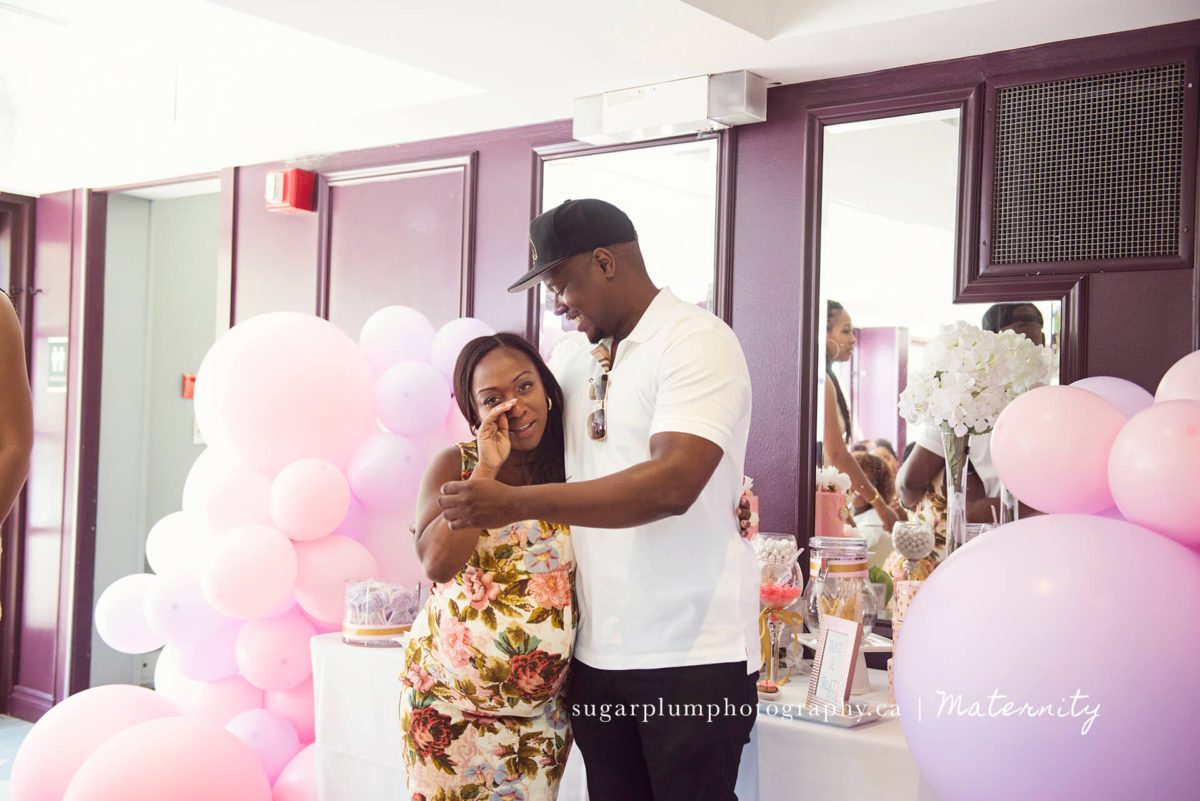 emotional pregnant mom embraced by husband