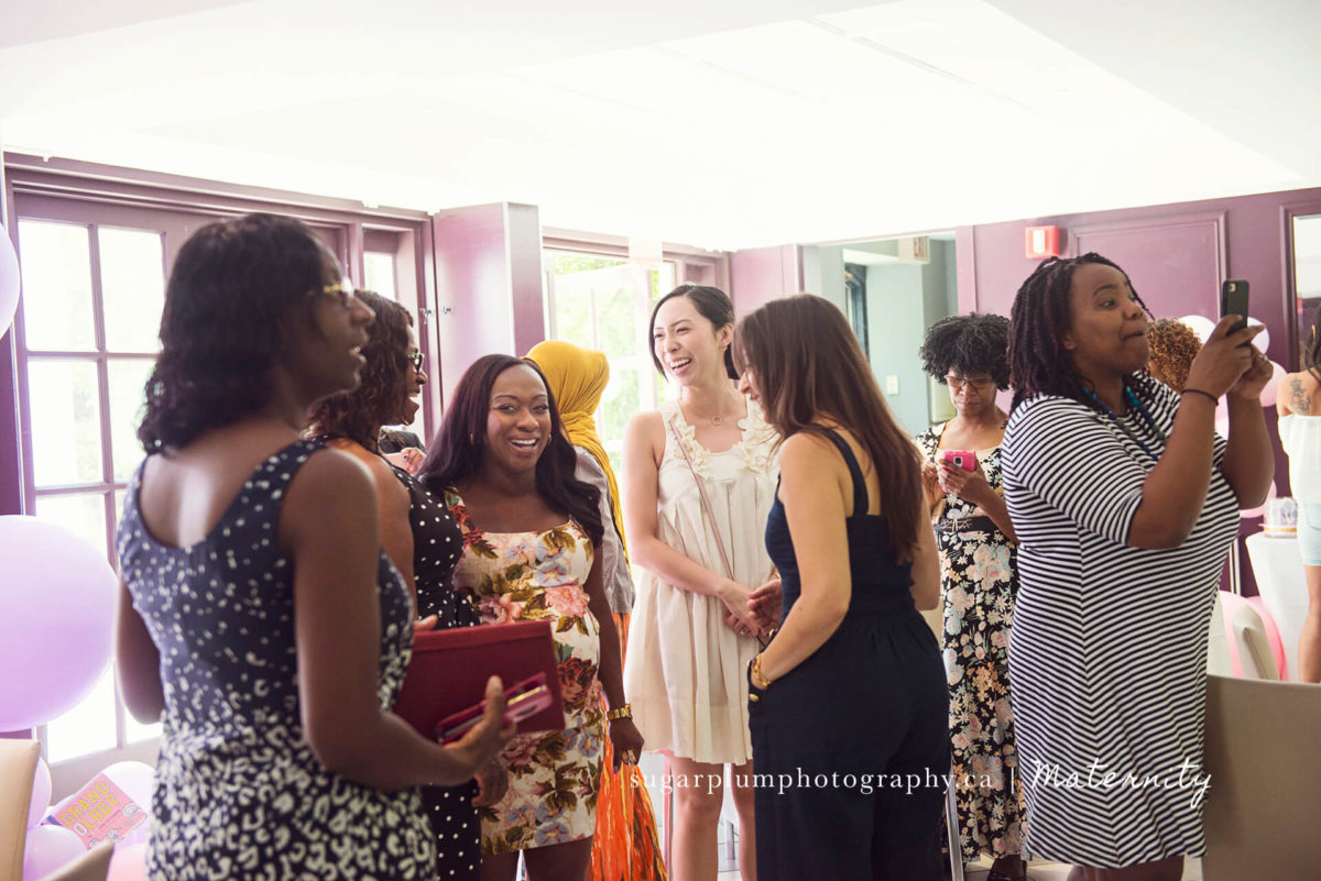 laughing with friends at baby shower venue