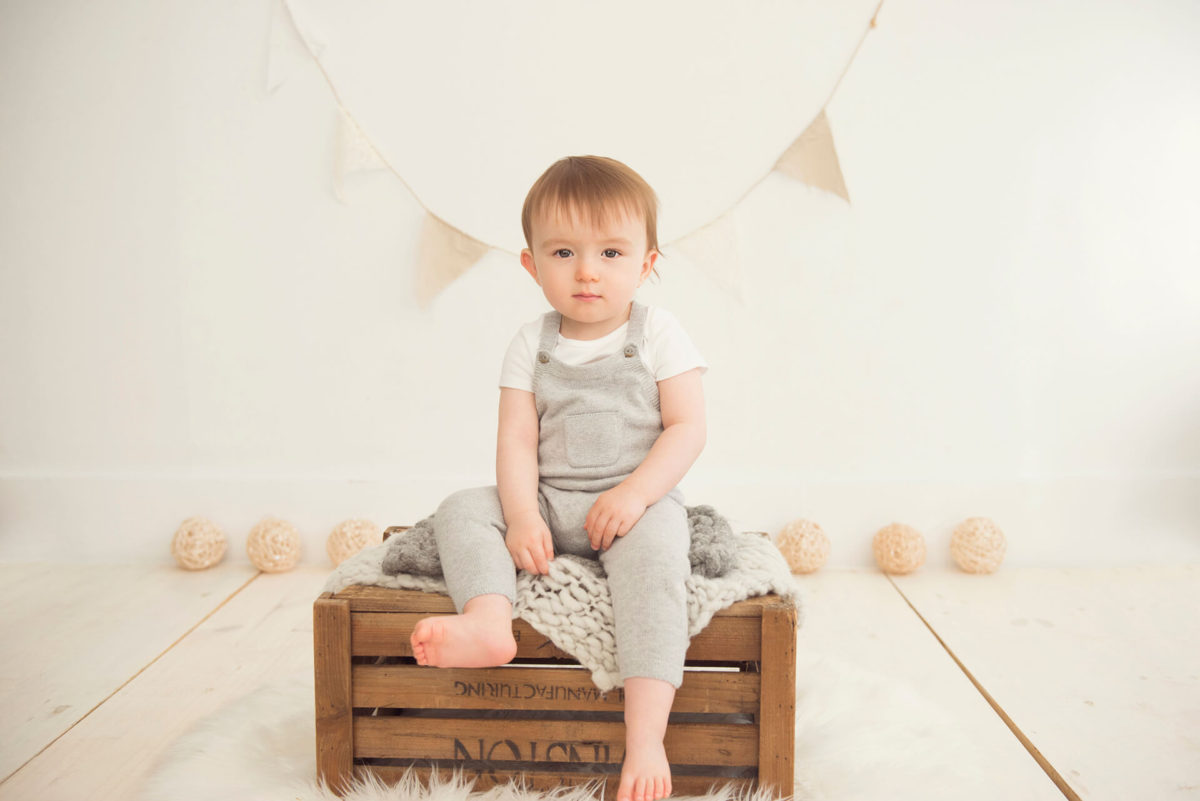 posed baby on crate