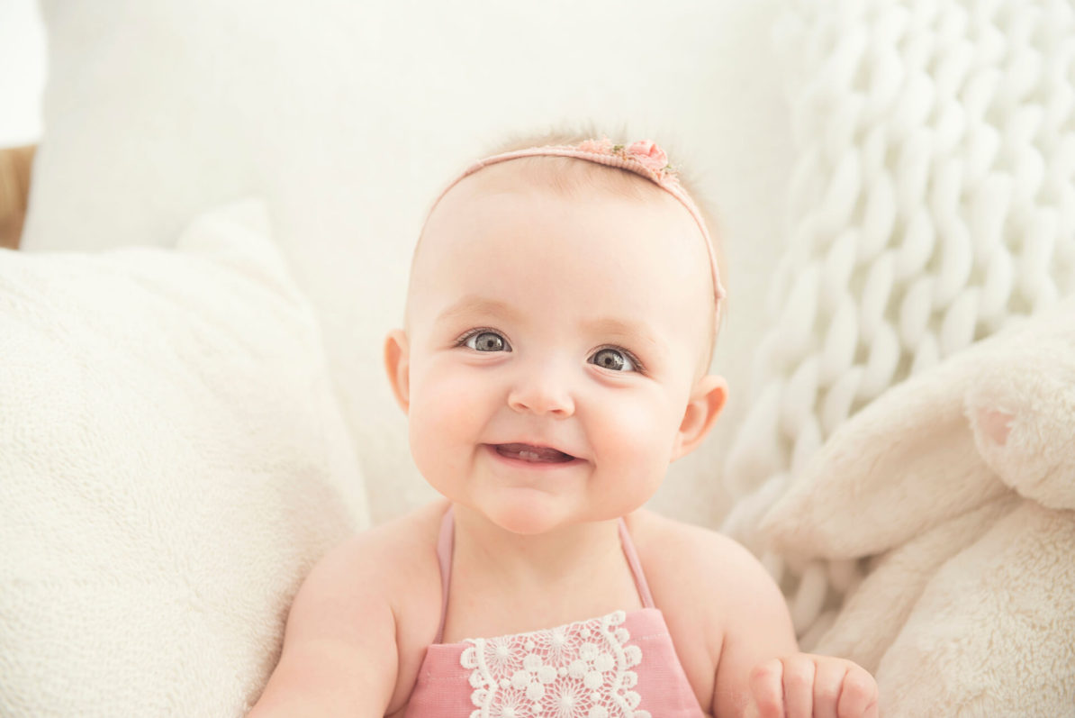 Smiling baby on fluffy chair