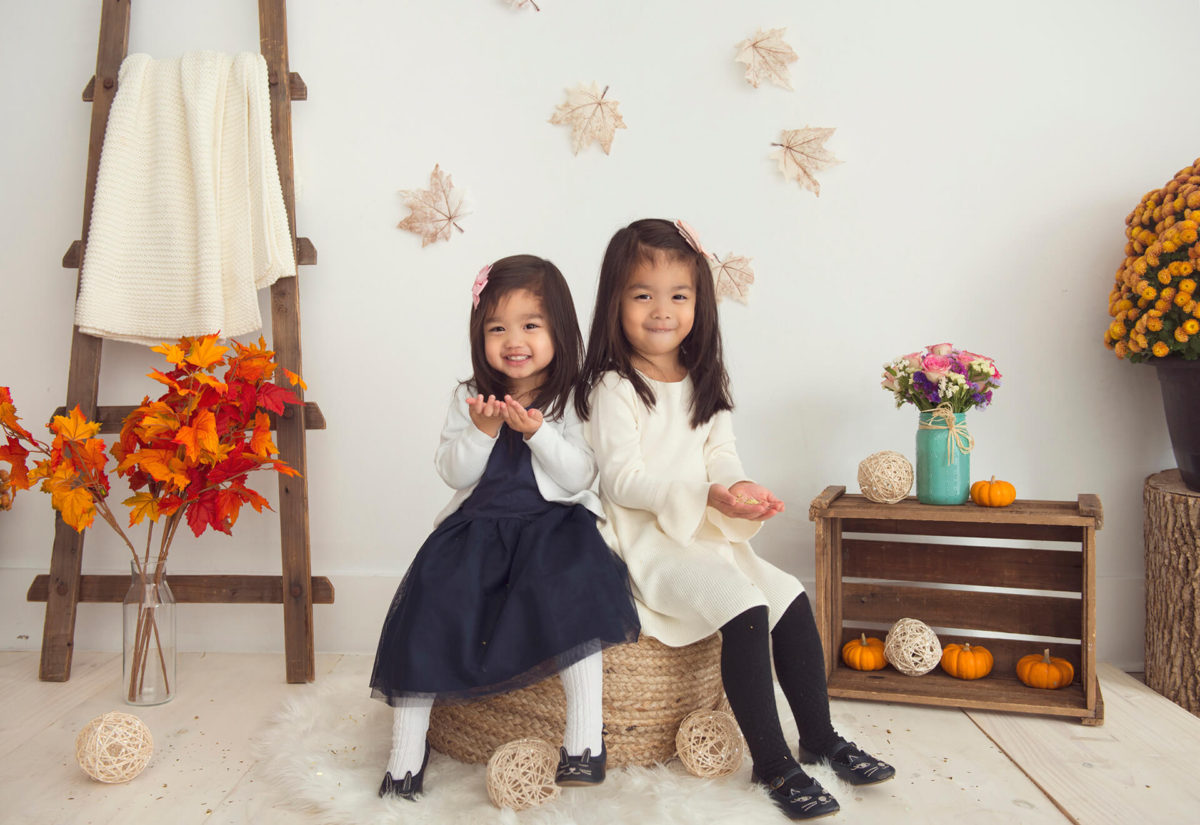 smiling kids on fall themed set